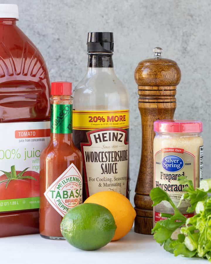 Tomato juice, Tabasco sauce, Worcestershire sauce, a pepper grinder, prepared horseradish, lemon, lime and celery.
